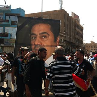 At a demonstration in Baghdad in September 2011, protestors hold up a picture of Hadi al-Mahdi, an Iraqi journalist shot dead at his home. (Photo: Khalid Waleed)