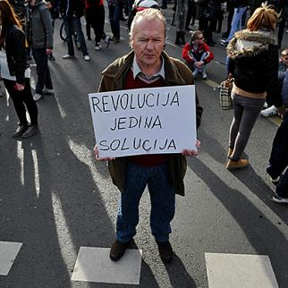 """Protest outside Bosnian state presidency, Sarajevo, February 17. The banner reads """"Revolution is the only solution"""". (Photo: Midhat Poturovic)"""
