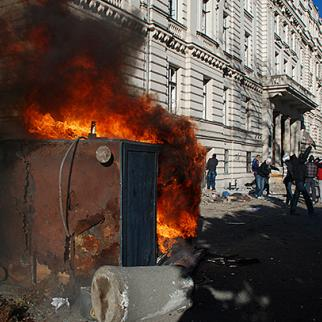 A security guard's kiosk burns next to the building of the Sarajevo Canton government. February 7, 2014. (Photo: Jim Marshall)