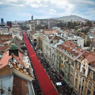 A broad ribbon of red chairs winds its way through Sarajevo, April 6, 2012.