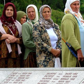 Bosniak women mourn victims of the Srebrenica massacre.