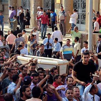 A funeral for one of the victims of the violence of October 9. (Photo: Bora S Kamel/Flickr)
