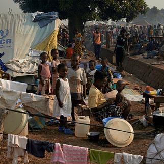 Internally displaced persons at Bangui's international airport in December 2013. An estimated 100,000 people have sought refuge there. (S. Phelps/Flickr)