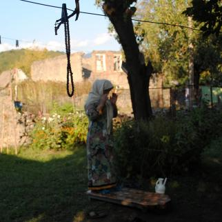 A woman from Tivi village praying.