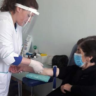 Nino Tvauri at the clinic where she works in Nikozi. (Photo: IWPR)