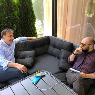 Mikheil Saakashvili, former Georgian president, in conversation with Vazha Tavberidze, an IWPR contributor in Georgia. (Photo: IWPR)
