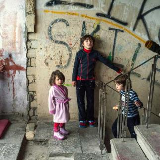 Children play on the stairs in the Bagebi dormitory; they have no other place to go.