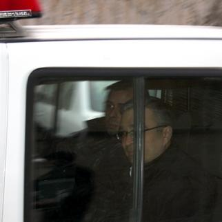 Ilgar Mammadov being driven away in a police car on the day of his arrest. February 2013. (Photo: Aziz Karimov)