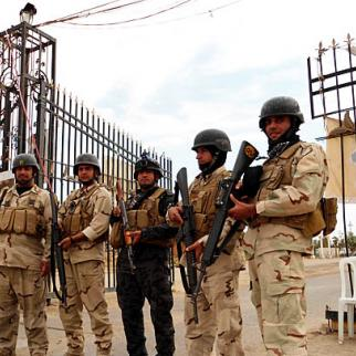 Iraqi security forces guard the camp, which houses many members of the Mojahedin-e Khalq, an insurgent group from Iran. (Photo: Ali Mohammed)