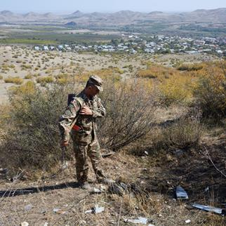 A soldier inspects the remains of a downed Azeri drone on the outskirts of Askeran on October 13, 2020 in Nagorno-Karabakh. (Photo: Alex McBride/Getty Images)