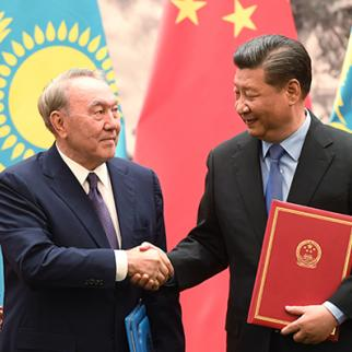 Kazakstan's President Nursultan Nazarbayev (L) shakes hand with Chinese President Xi Jinping during a signing ceremony on June 7, 2018, Beijing, China. (Photo: Greg Baker-Pool/Getty Images)