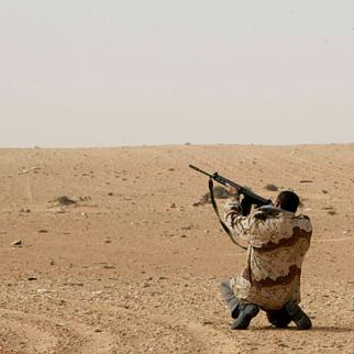 A rebel fighter near the town of Bin Jawad, March 2011. This man has a Belgian-made rifle taken from the Libyan military rather than the more usual Kalashnikov. The new government will struggle to gather in all the firearms now in private hands. (Photo: Nasser Nouri/Flickr)