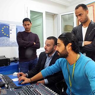 Trainees from Libya's Radio Zlitin train alongside Radio 6 engineers in Tunis. (Photo: IWPR)