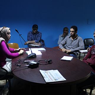 University students hold a planning session for TV programming during exercises at the Tripoli Media Lab in November 2014. (Photo: IWPR)