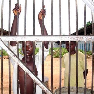 Two inmates at Osio prison near Kisangani await the outcome of an appeals court decision in May 2006. (Photo: Hugo Rami/IRIN)