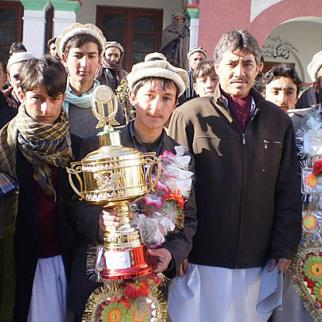Sarwaruddin receiving first prize in the debating competition. (Photo: Chitral Times)