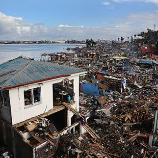 A man sits outside his home, the only one left standing in a particularly badly damaged area of Tacloban. (Photo: Dan Kitwood/copyright Getty Images)