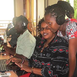 Rwandan journalists work on radio story ideas during IWPR training. (Photo: IWPR)