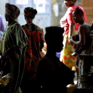 Sierra Leonian women buy and sell goods in a Freetown market. (Photo: Natalie Behring-Chisholm/Getty Images)