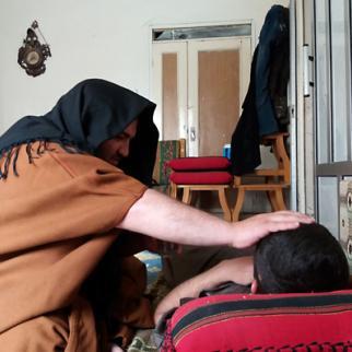 An al-Ruqyah al-Shar'iyyah session performed on a young man suffering from headaches. (Photo: Hazza Adnan al-Hazza)