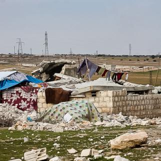 Residents of Bseida patch up their roofs using UNHCR tents. (Photo: Ali Dandoush)