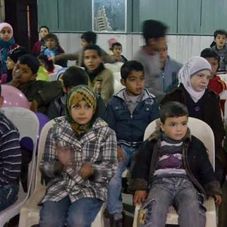 A children's celebration in Tariq al-Bab, Aleppo. (Photo: Damascus Bureau)