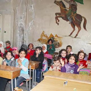 A dilapidated classroom in Aleppo's Amro bin As School. (Photo: Mahmud Abu Sheikh)