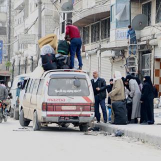 A displaced family from Aleppo's al-Fardous neighbourhood. (Photo: Hussam Kuwaifatiyeh)
