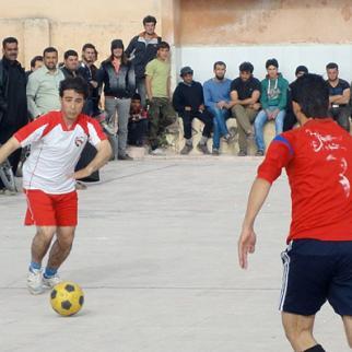 Footballers compete during a regional championship match. (Photo: Ahmad al-Salim)