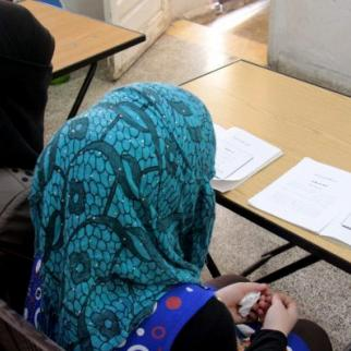 Women learning how to read and write in a literacy courses in the Idlib countryside. (Photo: IWPR)