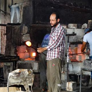 Heating the broken glass for an hour in the oven on a high temperature. (Photo: Sonia al-Ali)