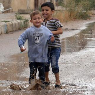 Syrian kids playing in a street. (Photo: Syria Stories)