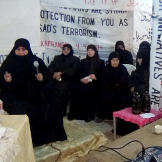 Umm Mohammad is honoured at the Mazaya centre during International Women's Day. (Photo: Ghalia al-Rahhal)