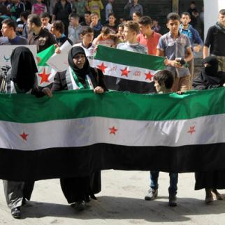 Women take part in a demonstration calling on Syrian factions to unite. (Photo: Mujahid Abu al-Joud)