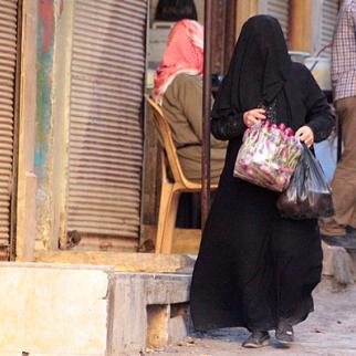 A woman shopping for groceries. (Photo by: IWPR)