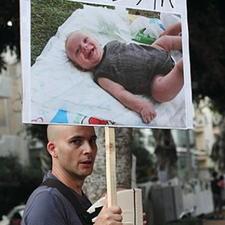 """A protester at Tel Aviv's tent protest. The sign reads, """"I don't have a house for him."""" (Photo: Yossi Gurvitz)"""