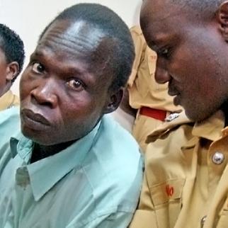 Thomas Kwoyelo at the start of his trial in Gulu high court. (Photo: Charles Akena/IRIN )