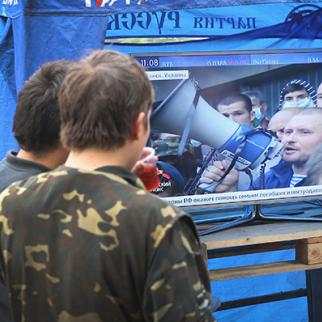 Pro-Russian activists watch a Russian news report about activities in Lugansk. (Photo: Scott Olson/Getty Images)