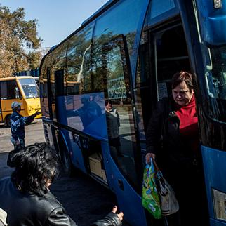 Passengers get off a bus that has come from Donetsk to Mariupol. (Photo: Brendan Hoffman © Getty Images)