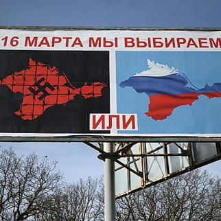 Billboard for the March 16 referendum. It offers a choice between Crimea under the Nazi swastika or under the Russian flag. (Photo: Sean Gallup/Getty Images)