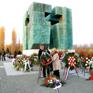 Visitors from Serbia laying flowers at a monument to those killed at the Ovcara farm. Yugoslav army soldiers took some 260 patients and staff from Vukovar's hospital and murdered them here. (Photo: Vladimir Dmitric)