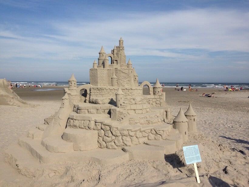 elaborate sandcastle on the beach with blue sky