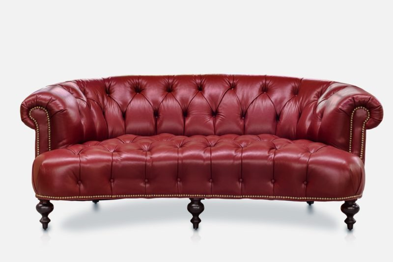 The Truman, A Button Tufted Curved Chesterfield In Red Leather