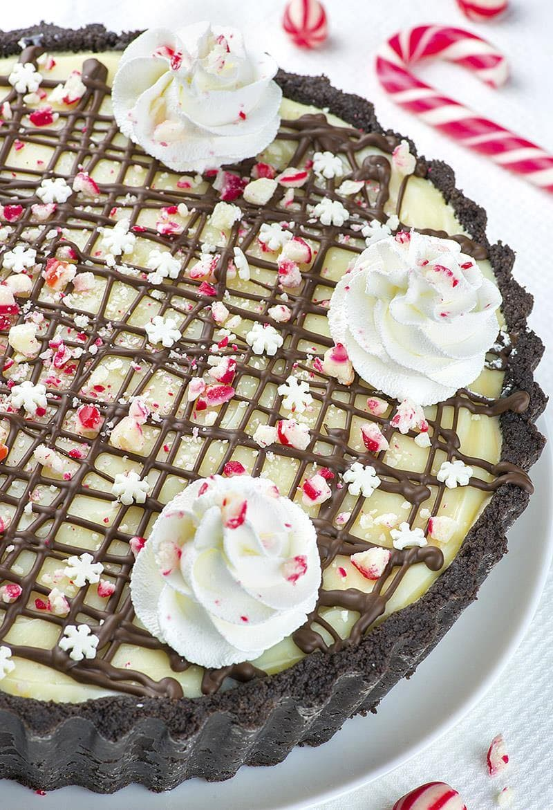 Candy Cane Pie is the only dessert recipe, you'll need this Christmas! It's no bake pie with crumbly Oreo crust and white chocolate ganache on top.