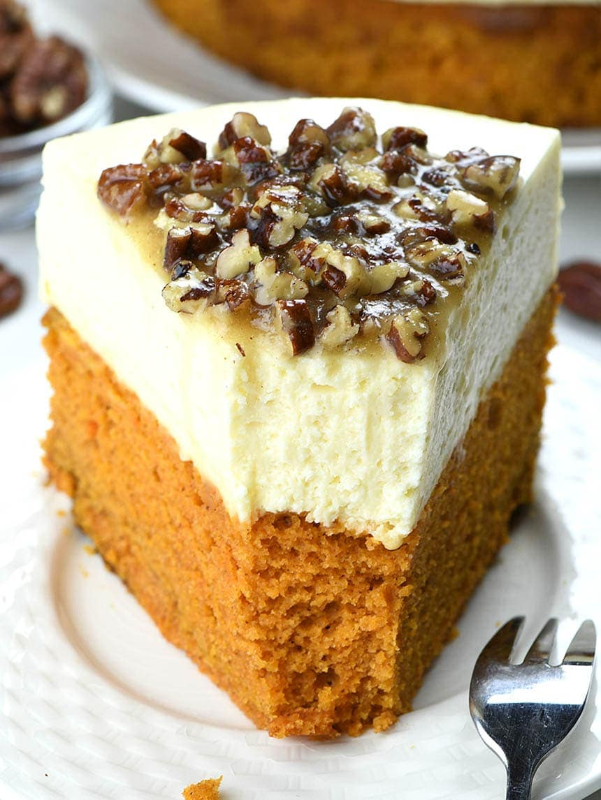 This year you can make a fun twist on classics and turn them into one delicious and festive combo- Pumpkin Bread Cheesecake with Pecan Praline Topping.