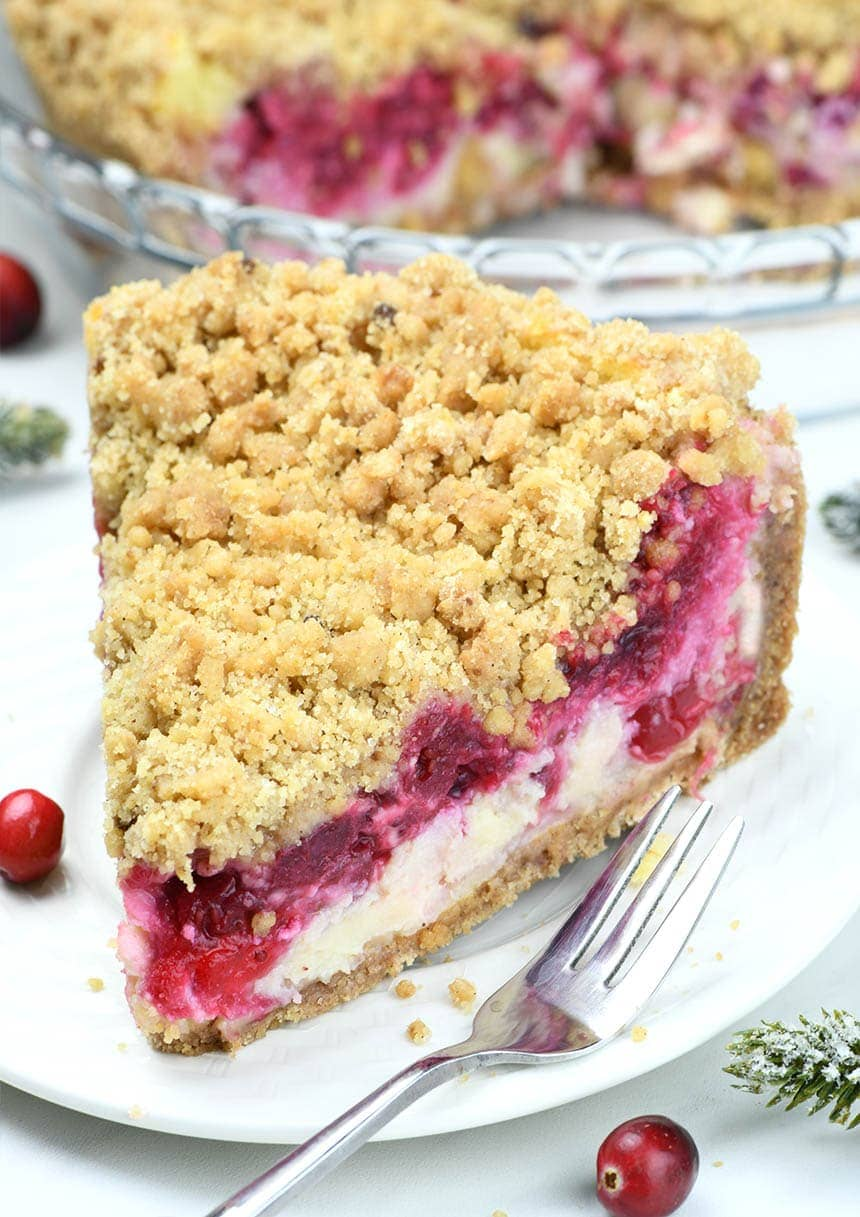 Cranberry Cheesecake Pie is a fun twist on classic desserts! It's a delicious layered dessert that combines cheesecake, cranberry sauce, and cinnamon sugar cookie.