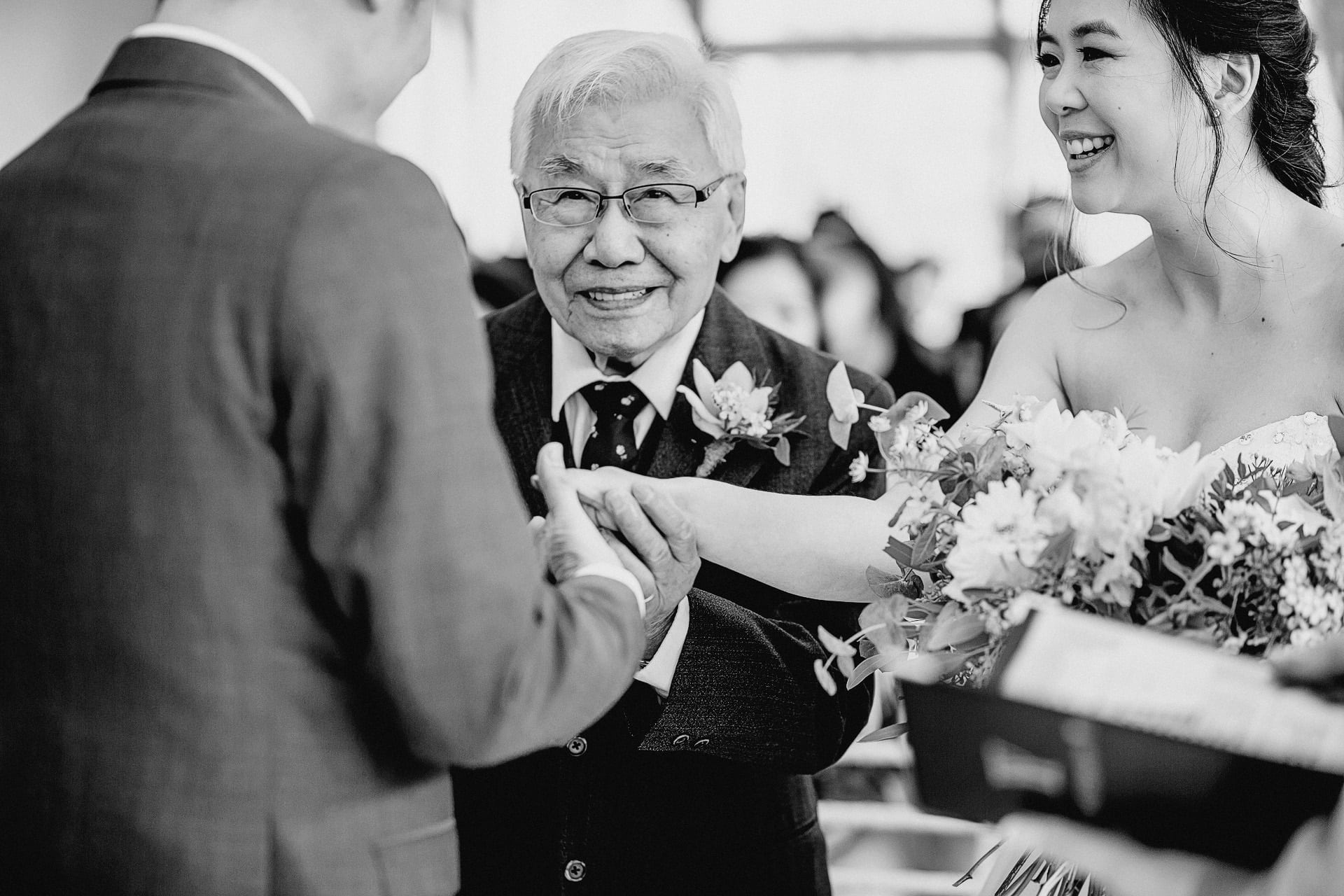 black and white photo of the bride being given away at combermere abbey wedding