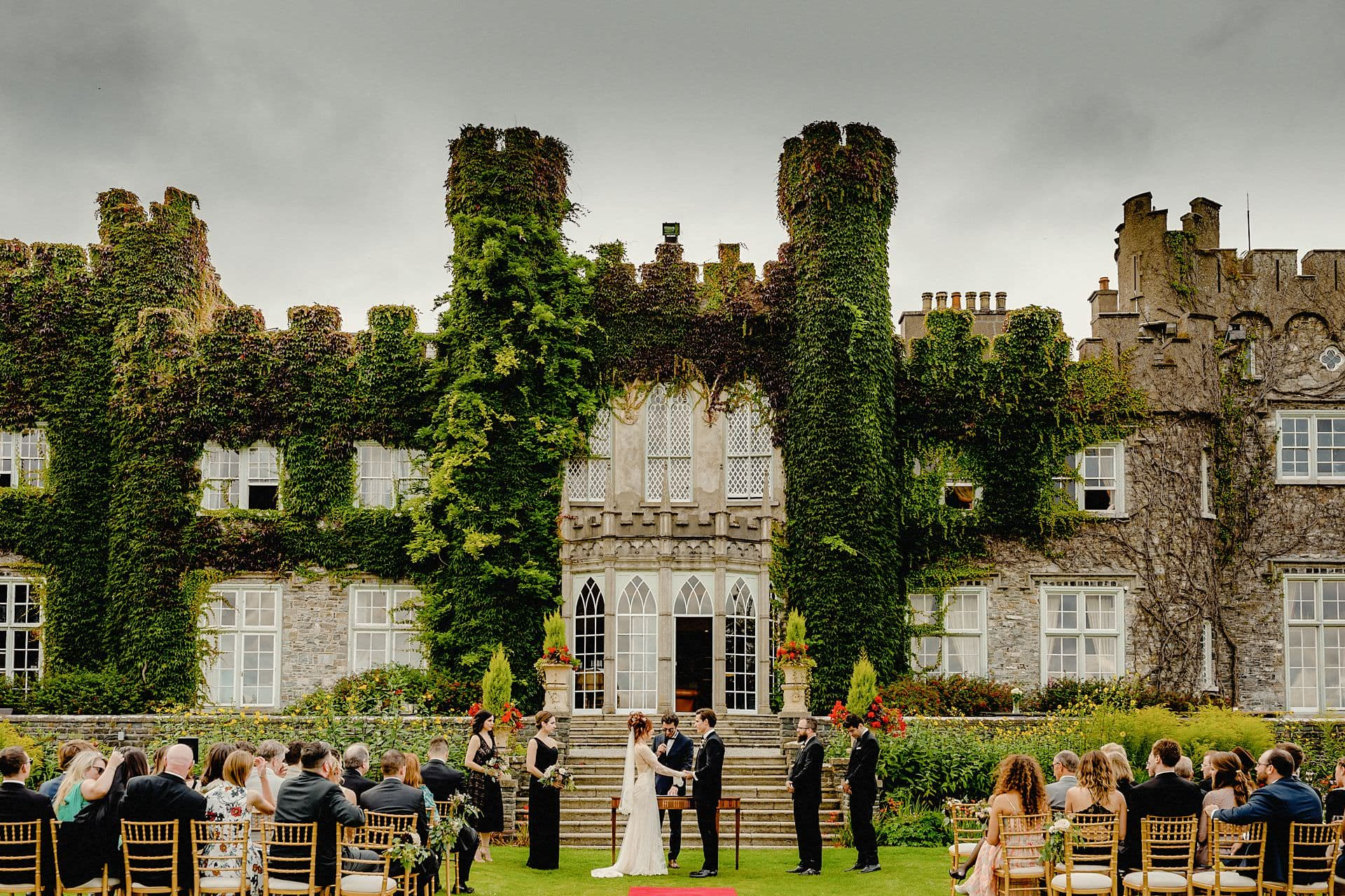 wedding ceremony outside the castle at luttrellstown