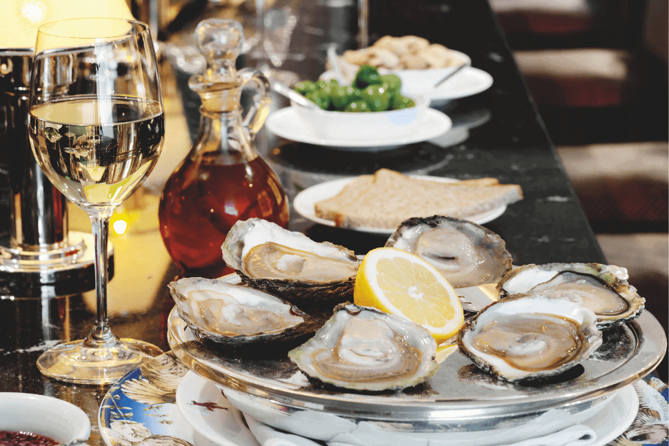 Oysters and wine on the bar at Wiltons, St James's