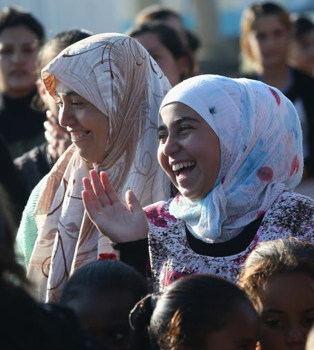 Yazidi refugees celebrate news of the liberation of their homeland of Sinjar from ISIL extremists, while at a refugee camp on November 13, 2015 in Derek, Rojava, Syria.